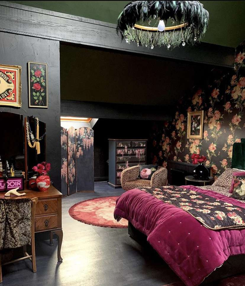Dark colored bedroom with floral wallpaper