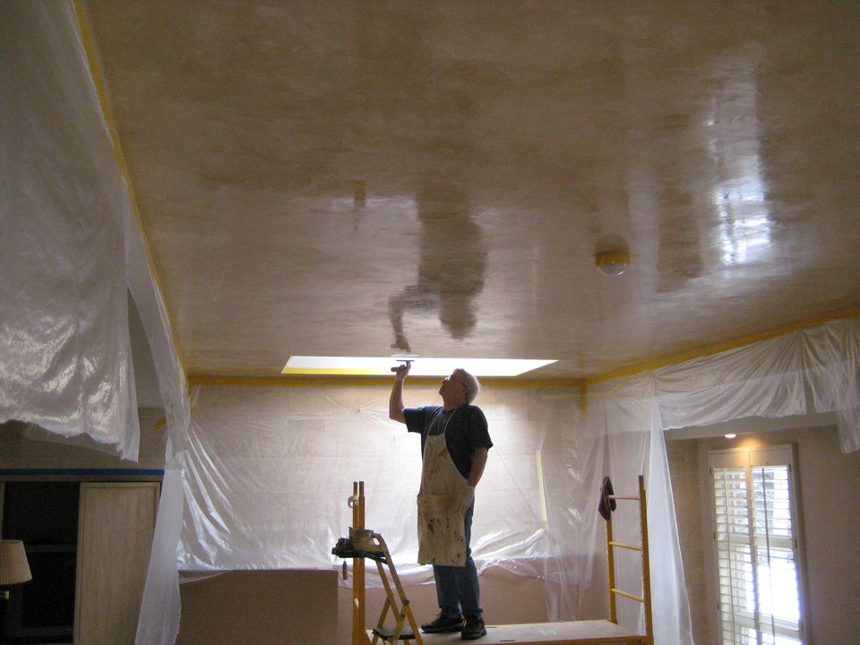Man applying Venetian plaster to ceiling