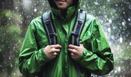 Man wearing a green rain jacket