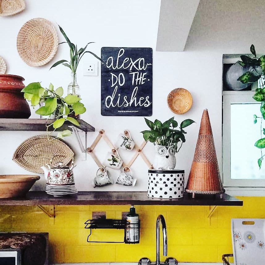 Yellow kitchen with hanging baskets