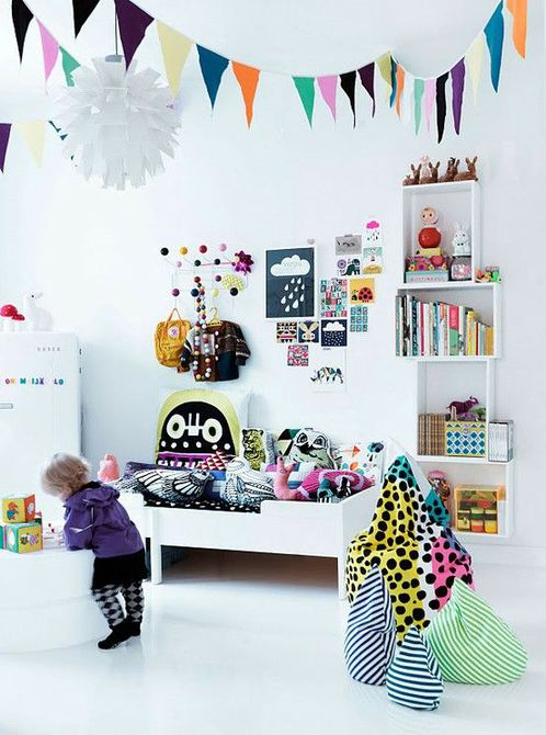 White, Scandinavian style kid's room with colorful decorations