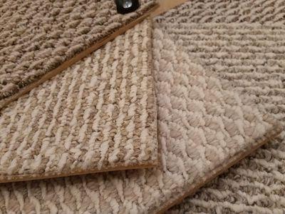 Kanga-backed berber carpet samples