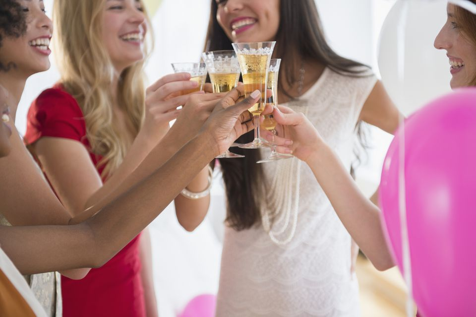 Women toasting each other with champagne at bachelorette party