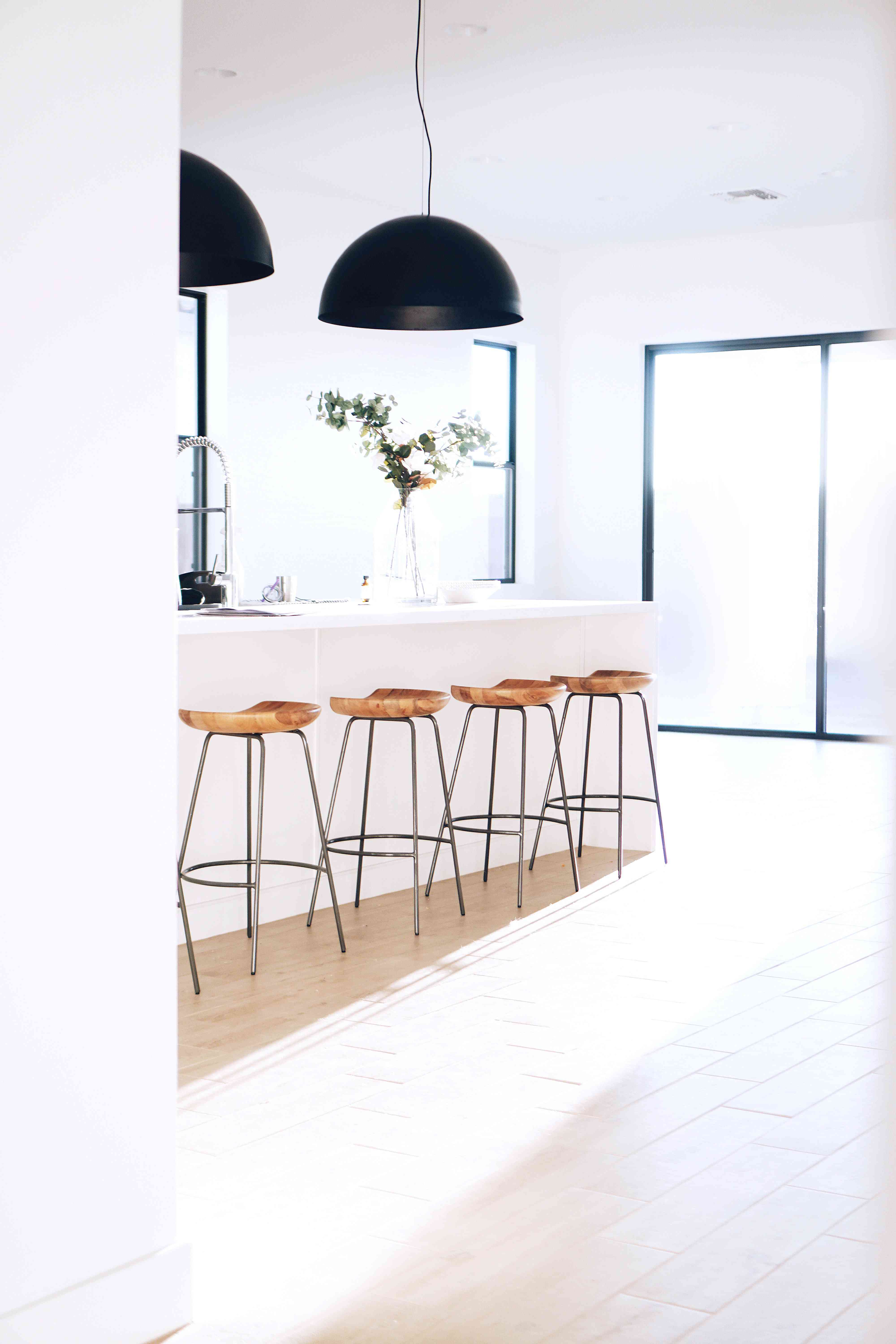 Light soaked kitchen with white walls