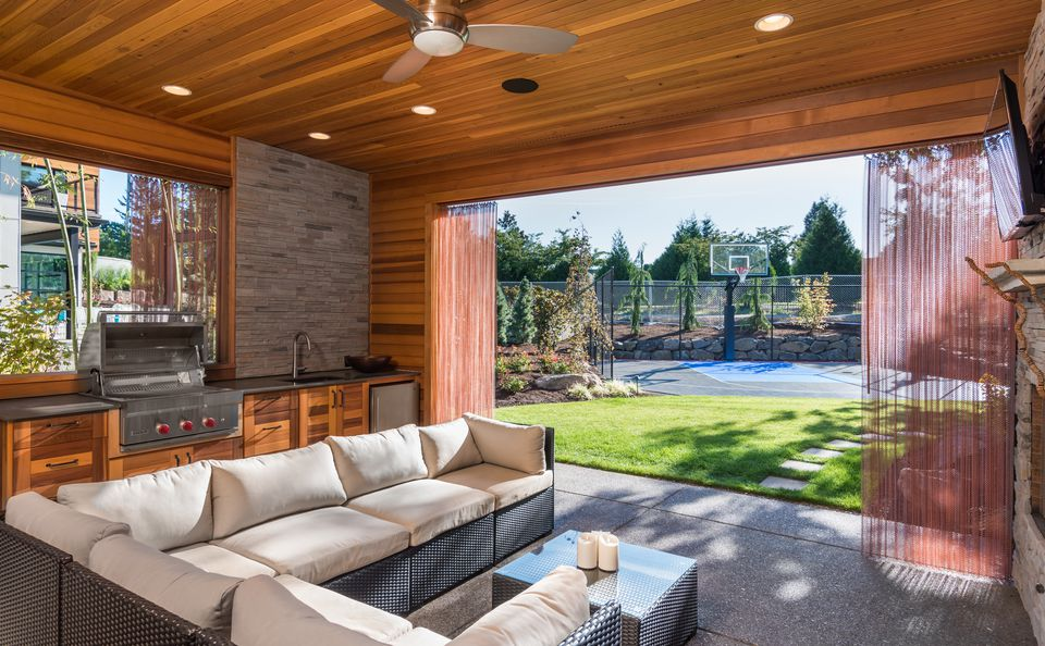 luxurious covered patio with barbecue and sink
