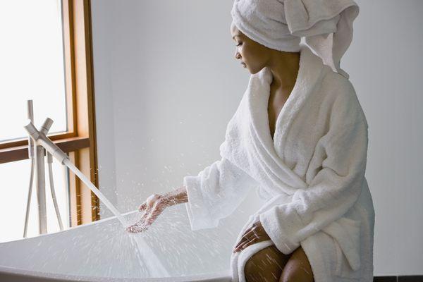 Woman filling bathtub
