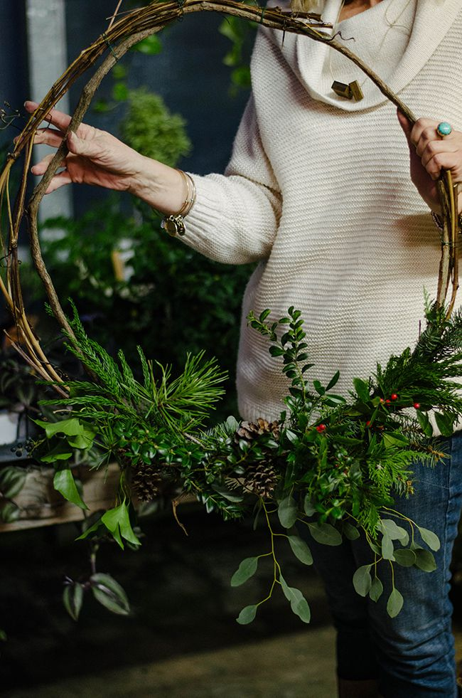Woman holding a natural wreath