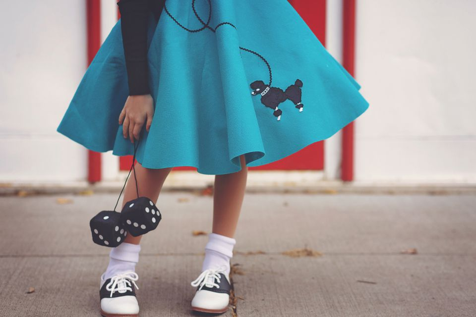 girl in poodle skirt and saddle shoes