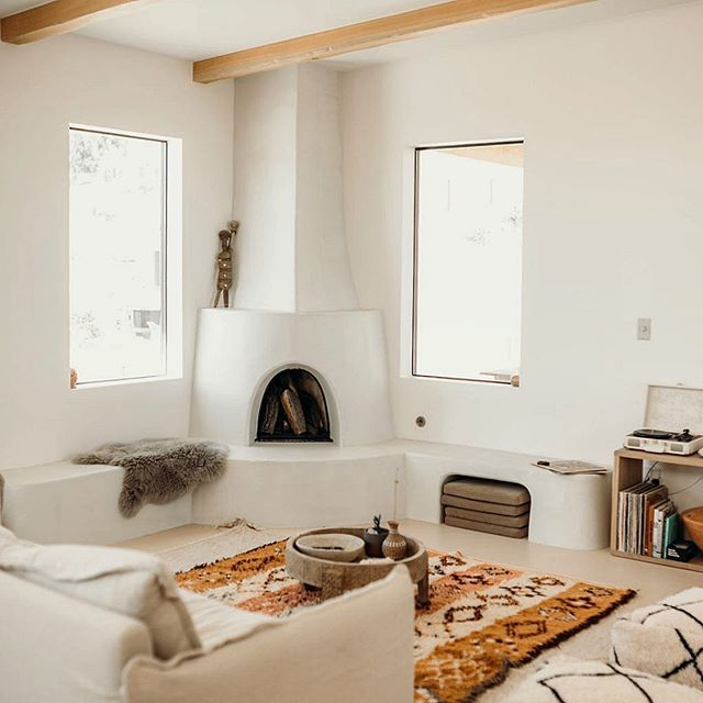 Living room with adobo style fireplace