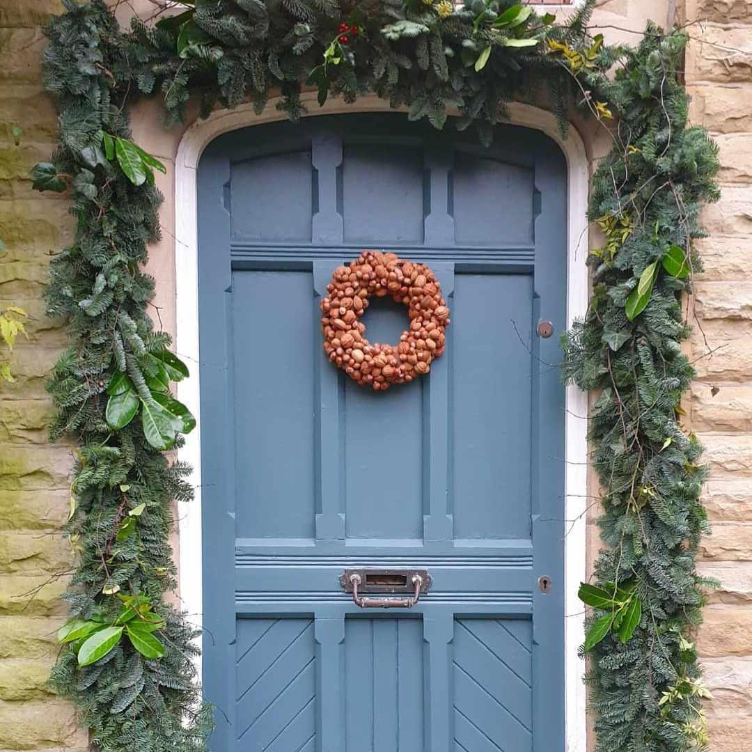 Blue door with nut wreath