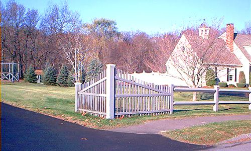 Picture of corner picket fence used in conjunction with another fence.