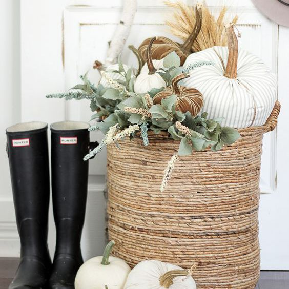 Pumpkins and greenery in a basket