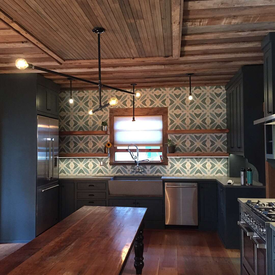 Blue cabinets and wooden ceiling