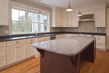 Custom Kitchen With Granite Slab
