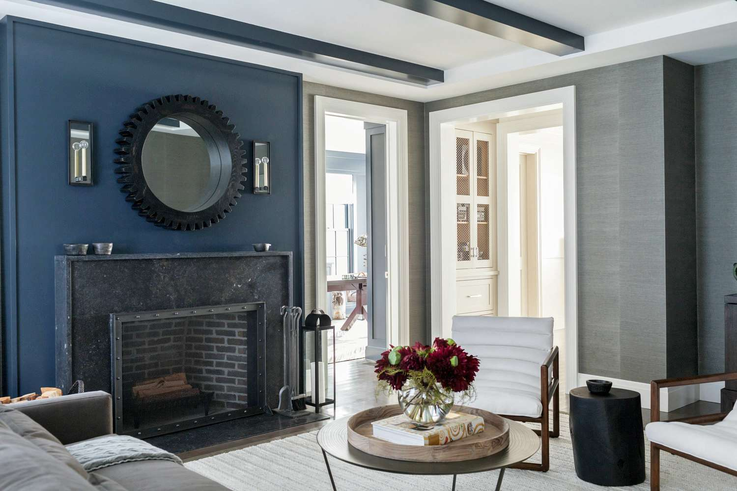 Black marble fireplace with metal rivets
