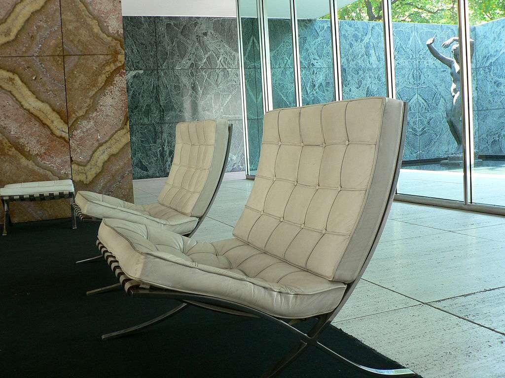 Side view showing curved back of Barcelona chair