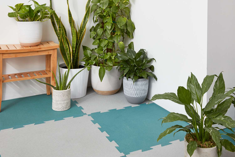 Self-adhesive rubber floor tiles