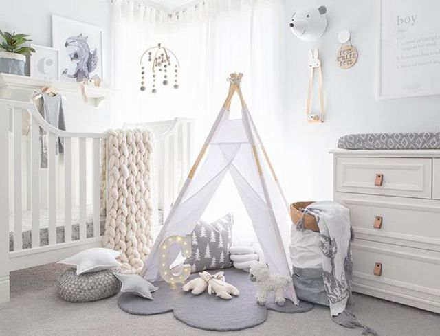 White, Nordic-inspired nursery with teepee