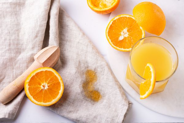 orange juice and stains on a towel