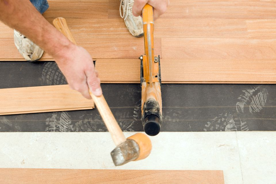 Worker Installing Hardwood Floor