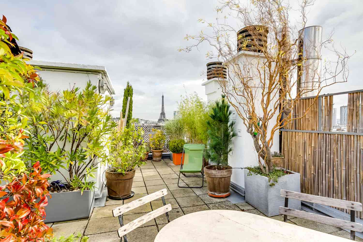 Rooftop garden during the fall with Eiffel Tower in the distance.