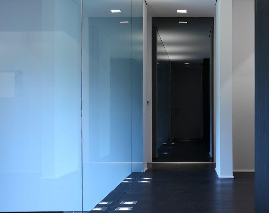 Recessed floor lights down a hallway.