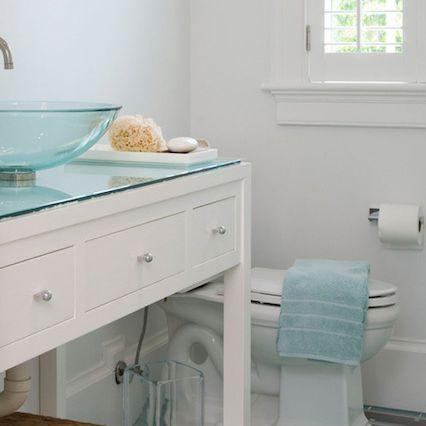 Beachy bathroom with blue tile floor