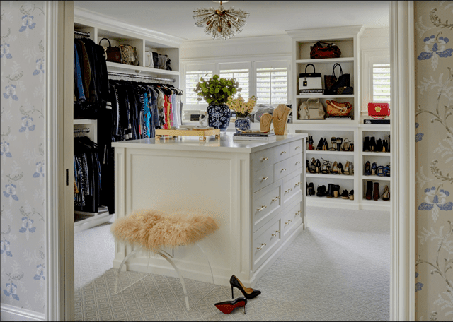 Large walk-in closet with sputnik light fixtures