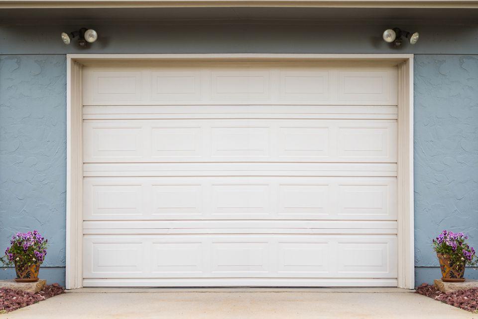 Blue house with white garage door