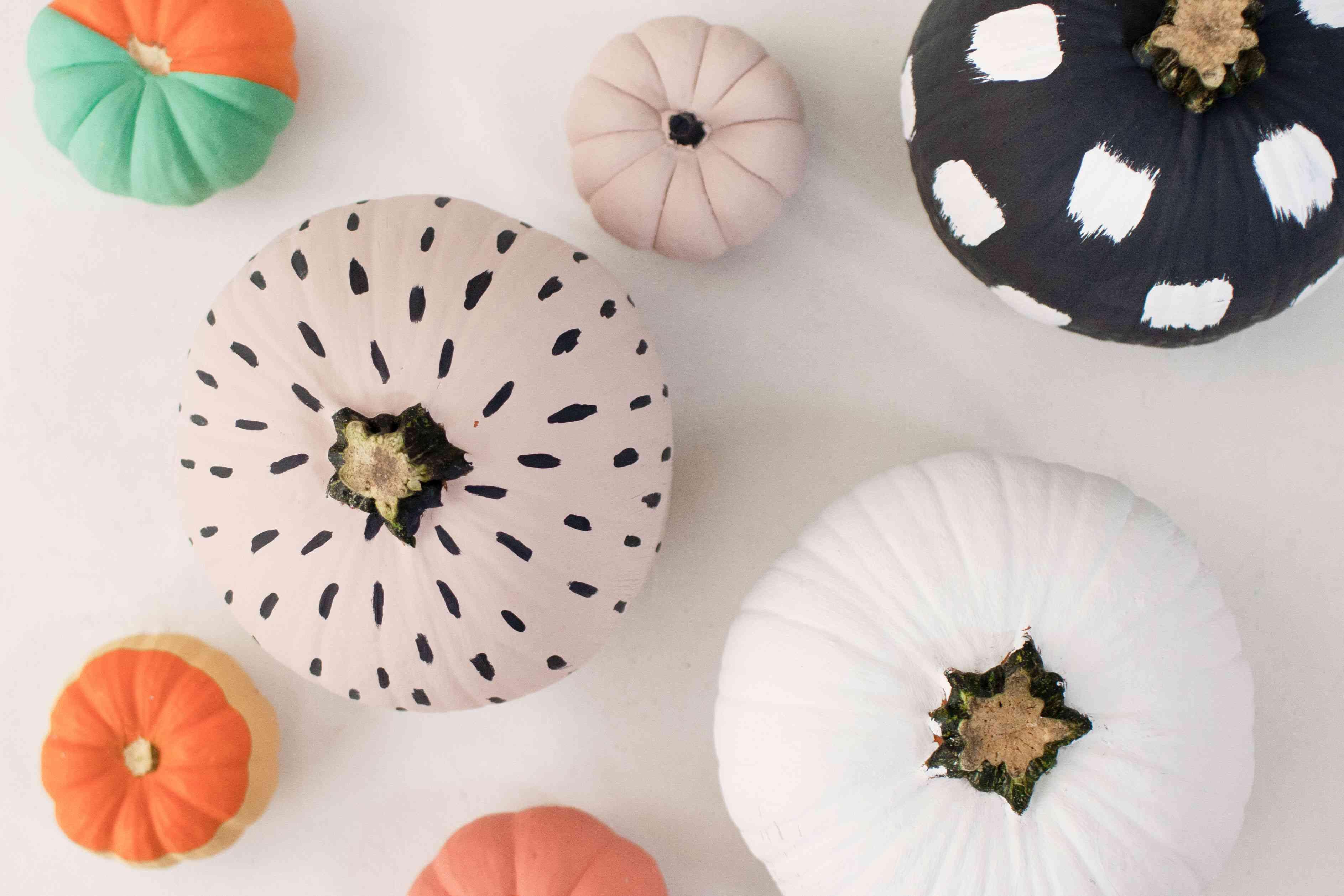 Patterned pumpkins on white background