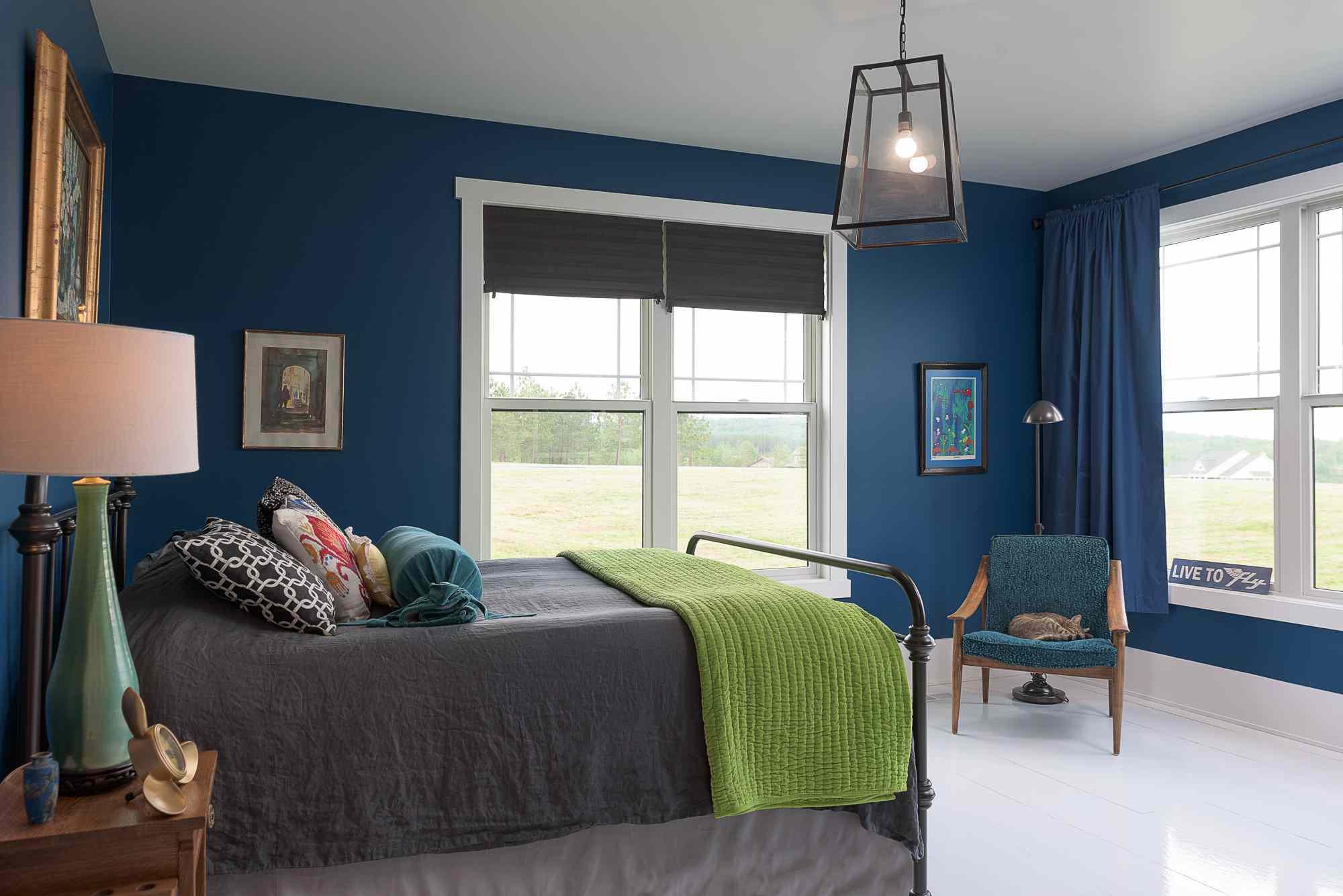 Blue bedroom with oversize light fixtures