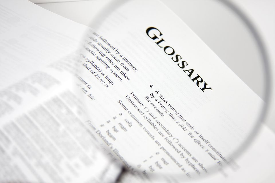 Magnified view of glossary law in a book