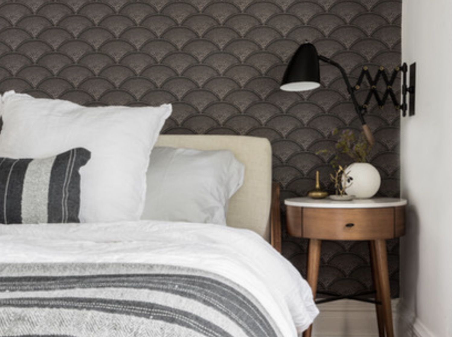 modern neutral bedroom with geometric pattern accent wall
