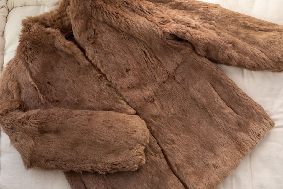 fur coat on a flat surface