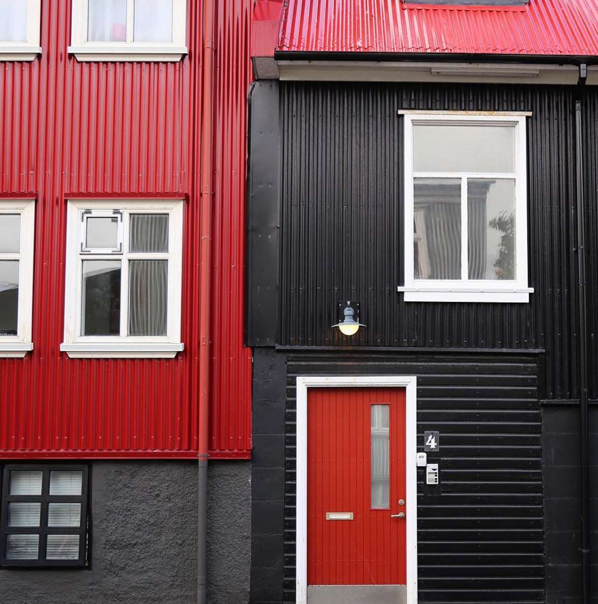 black and red siding on a house