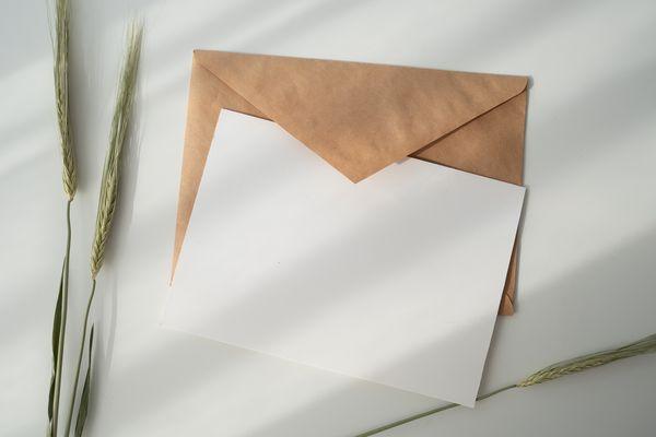Blank card on top of brown envelope