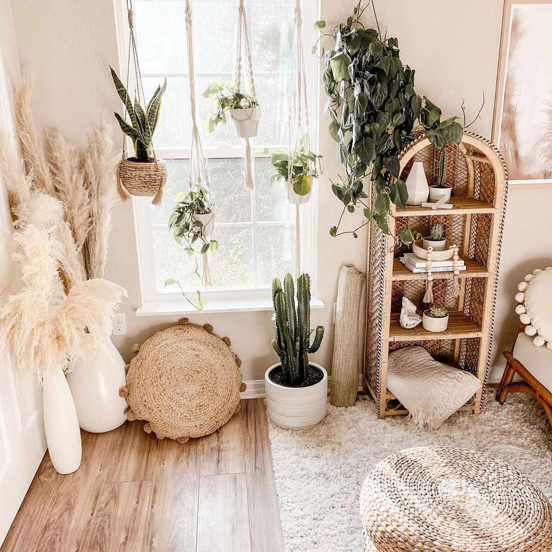 Living room with hanging plants and wicker furniture