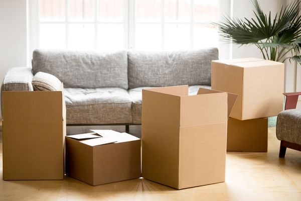 Cardboard carton boxes in living room, packing and moving concept