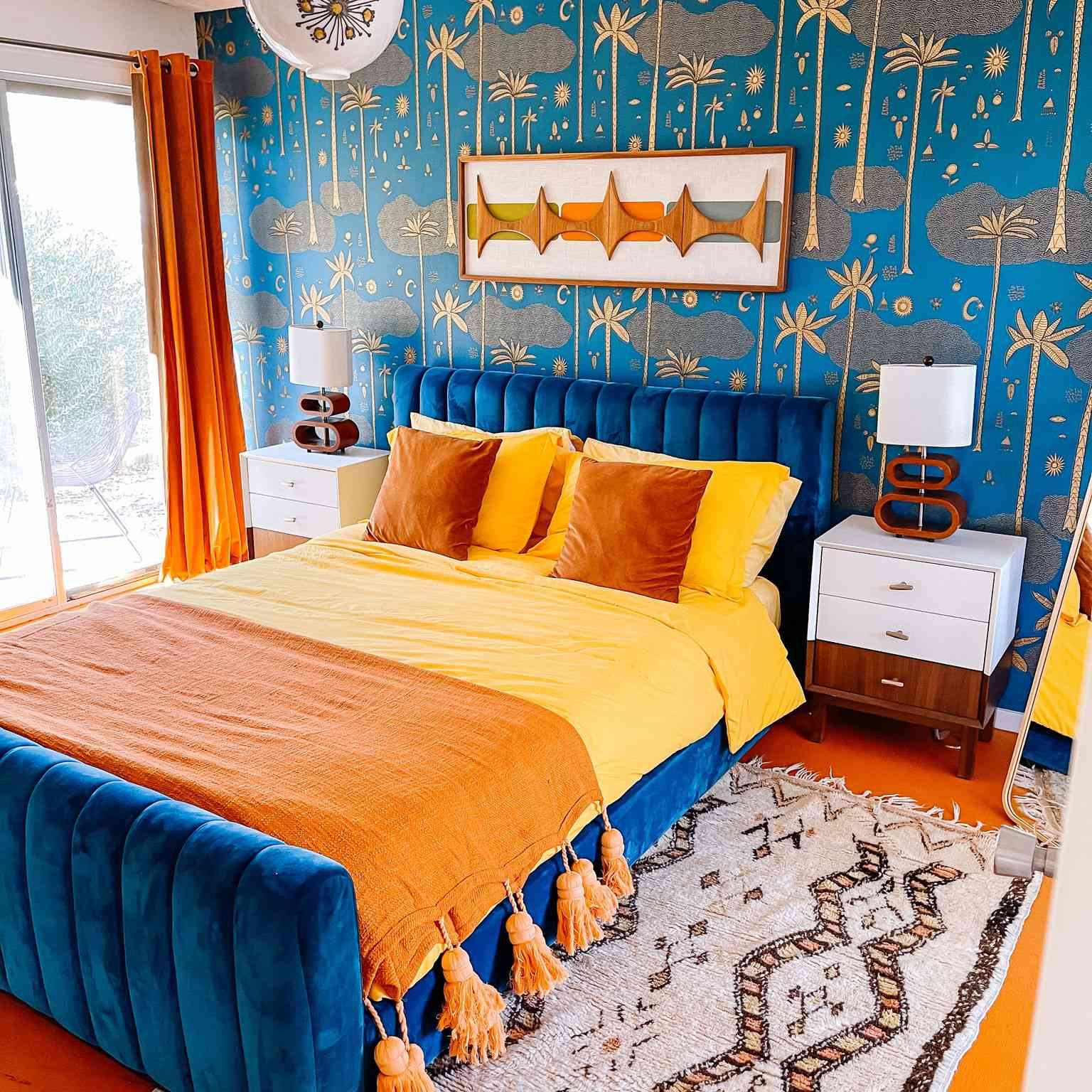 eclectic orange and blue bedroom with touches of yellow