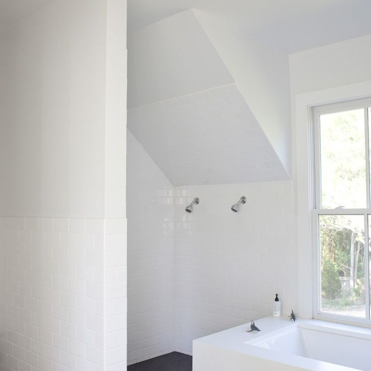 Attic bathroom with shower with two shower heads