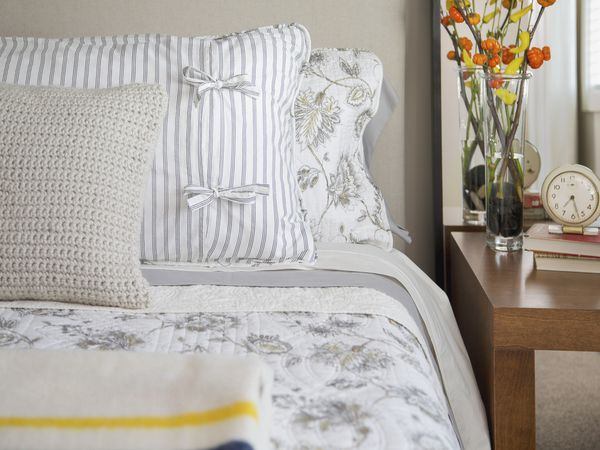 bright bedroom with white-and-gray bedding