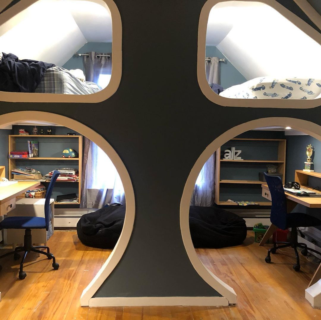 A DIY loft for two boys with beds on top and homework stations on the bottom.