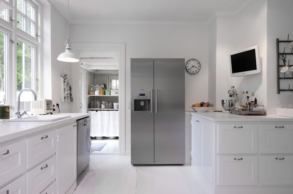 White kitchen with silver upright fridge