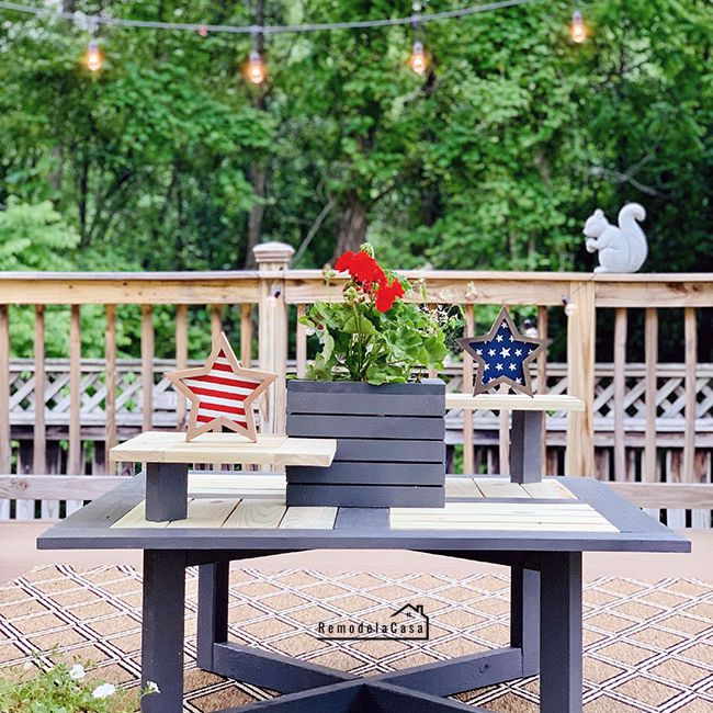 An outdoor coffee table on a deck