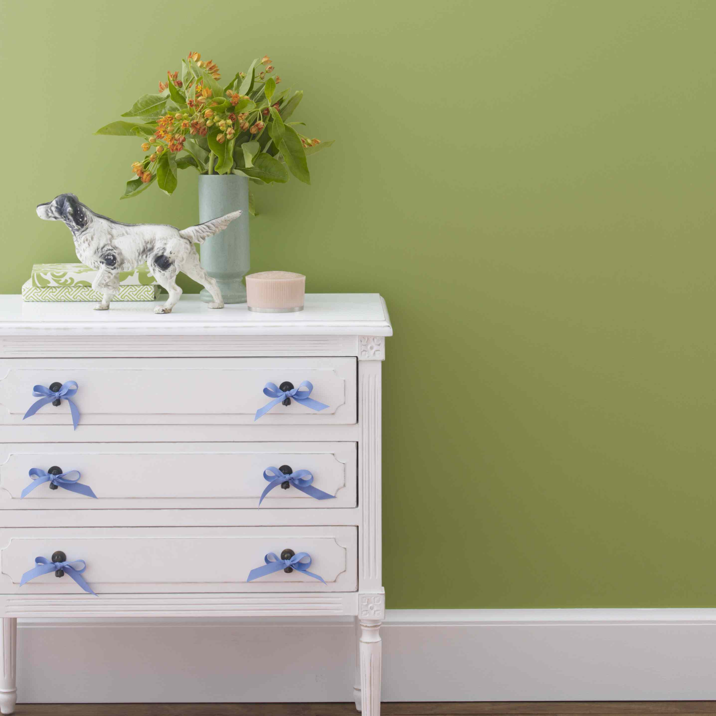 devorative chest with green painted wall