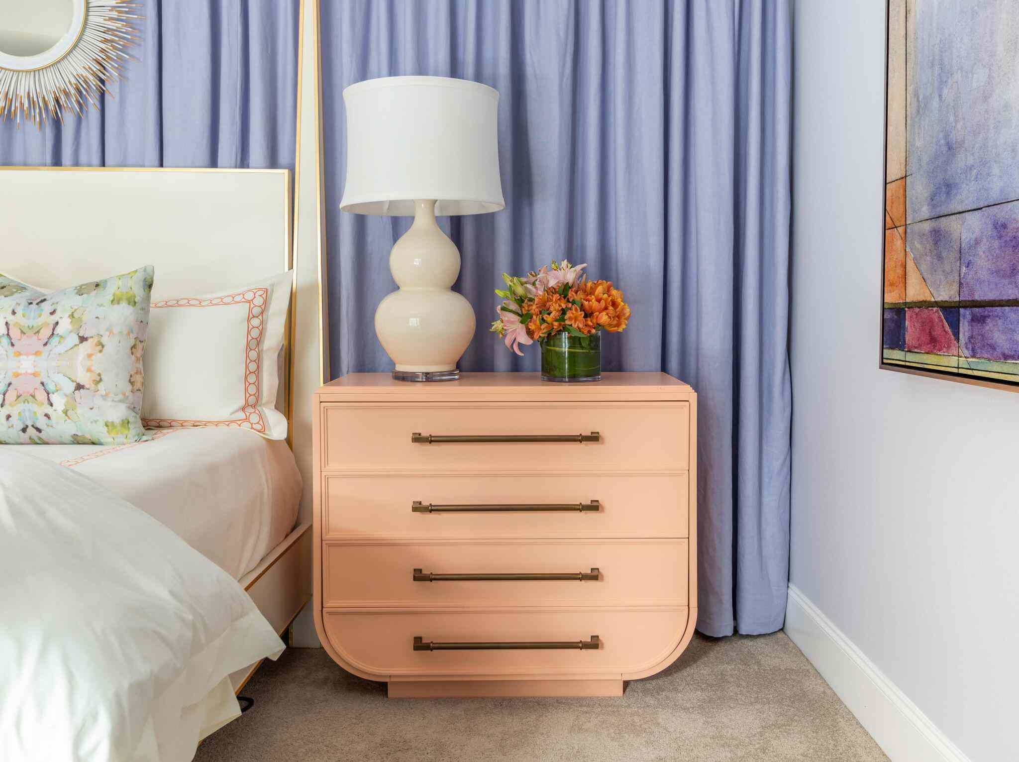 light coral dresser in colorful bedroom