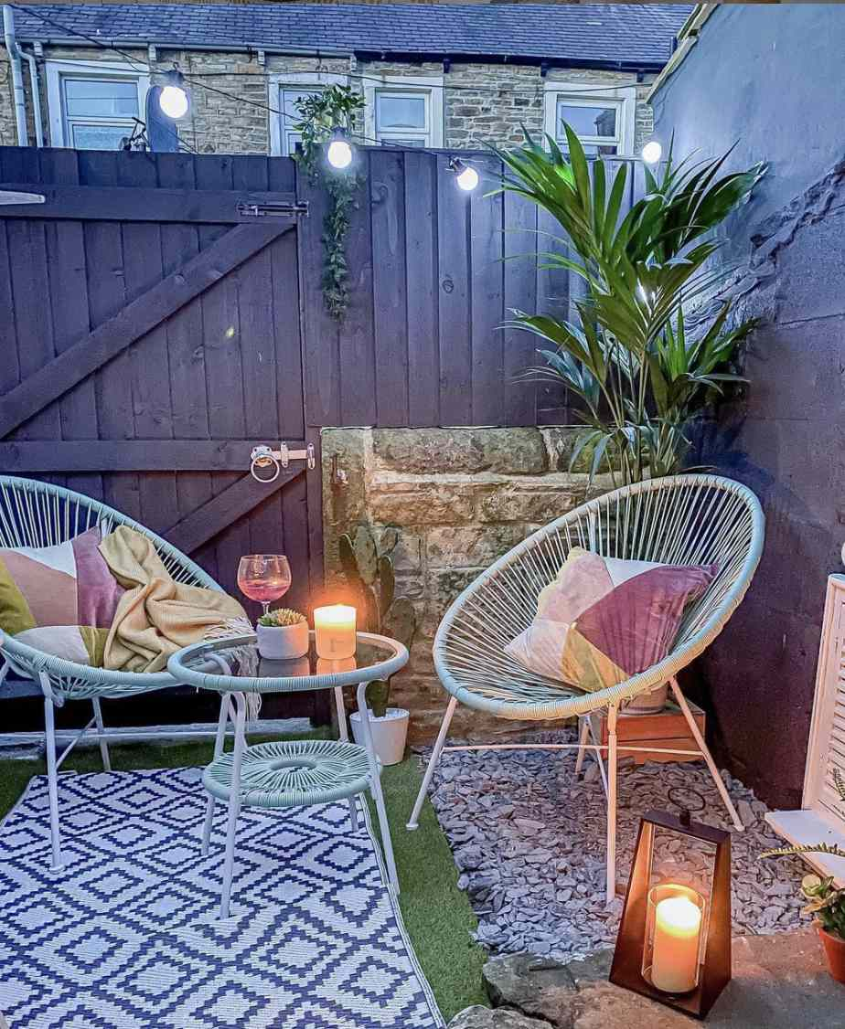 patio setting with string lights and candles adding ambiance
