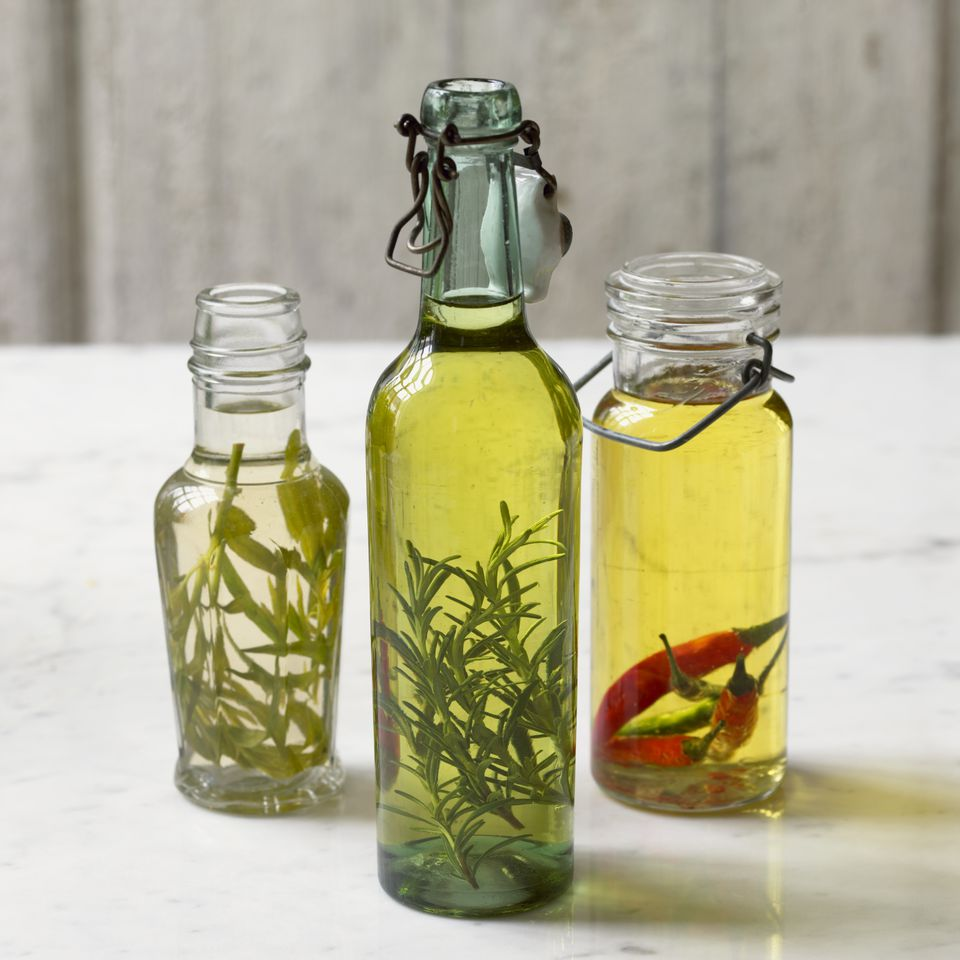 Bottles of olive oil flavoured with tarragon, rosemary, and red chilli