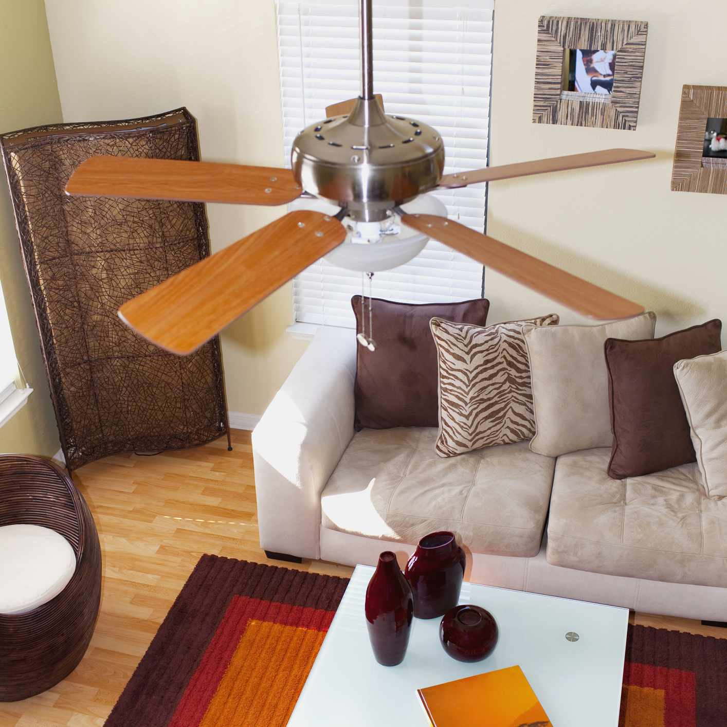 use a duster to clean ceiling fans and light fixtures