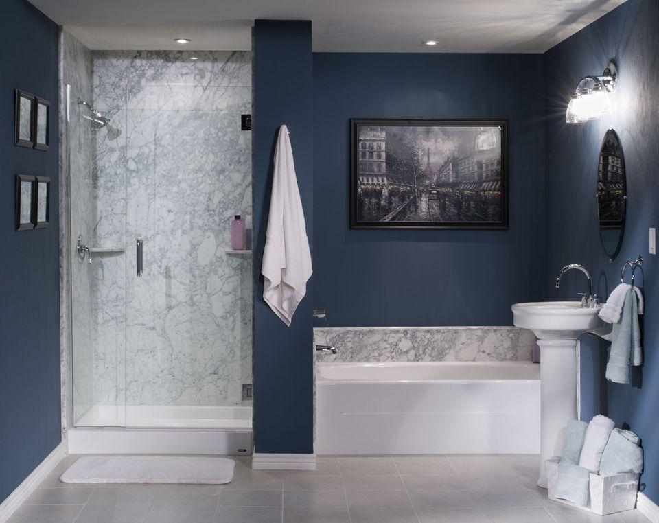 pedestal sink in navy blue bathroom